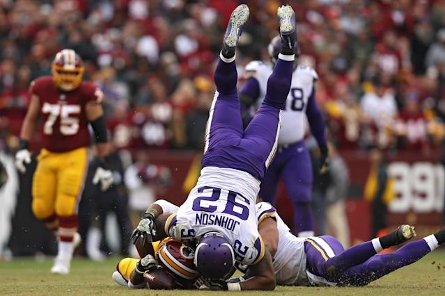 <p>Running back Chris Thompson #25 of the Washington Redskins is tackled by defensive tackle Tom Johnson #92 of the Minnesota Vikings during the fourth quarter at FedExField on November 12, 2017 in Landover, Maryland. (Photo by Patrick Smith/Getty Images) </p>