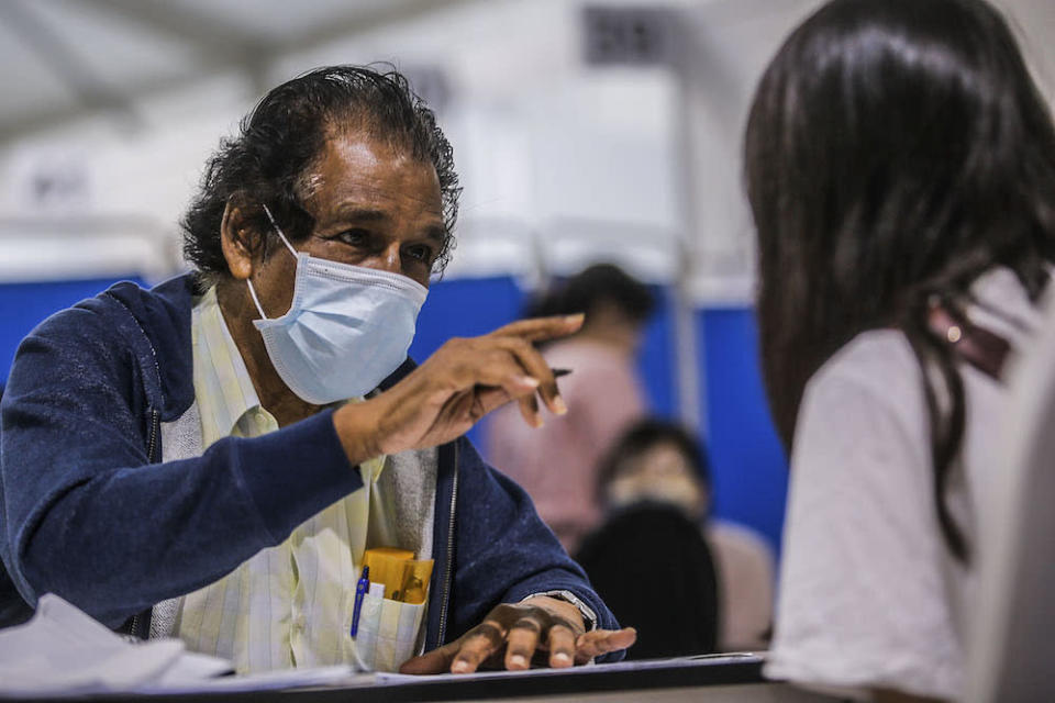 Volunteer M. Selvarajan is pictured at the vaccination centre (PPV) in Bukit Jalil June 27, 2021. ―  Picture by Hari Anggara