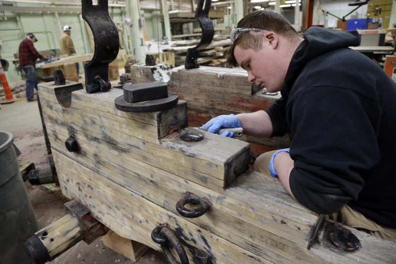 A maintenance facility worker restores wood for the USS Constitution, Wednesday, April 5, 2017, at the Charlestown Navy Yard in Boston. The world's oldest commissioned warship afloat is scheduled to return to the waters in late July. (AP Photo/Elise Amendola)