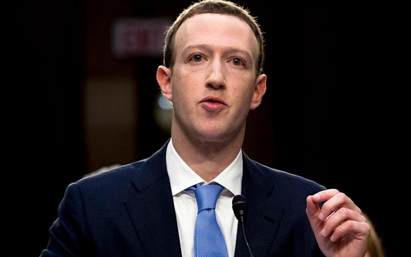 In this April 10, 2018, file photo, Facebook CEO Mark Zuckerberg testifies before a joint hearing of the Commerce and Judiciary Committees on Capitol Hill in Washington - Andrew Harnik/AP
