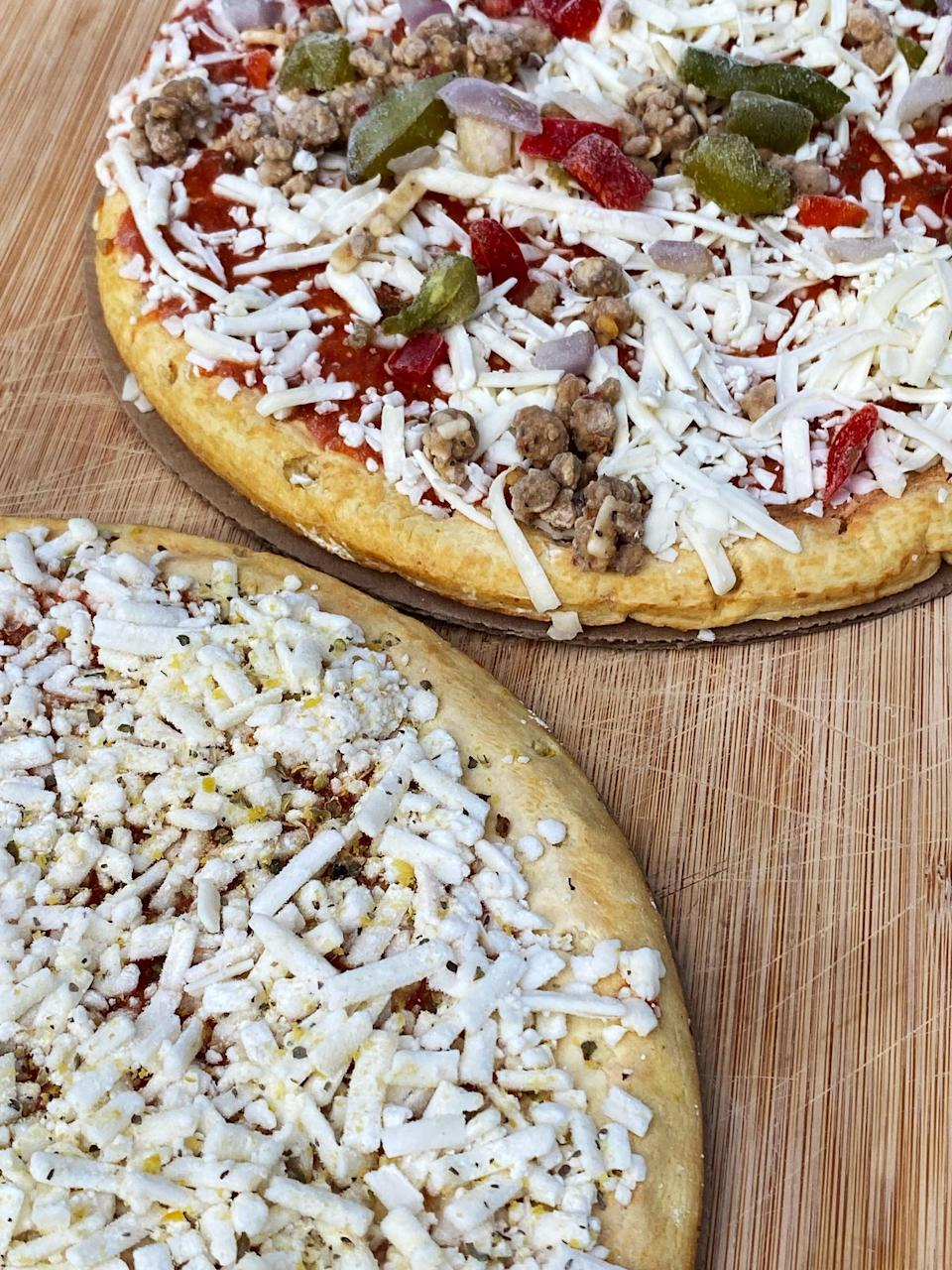<p>Here's what the frozen pizzas look like before I popped them in the oven. I was pleasantly surprised at how much cheese they both had. And the toppings amount was decent on the Supreme pizza, although a little more would have been better. I baked these on a pizza stone in my oven at 400 °F, but the package said you can just place it on the rack.</p>