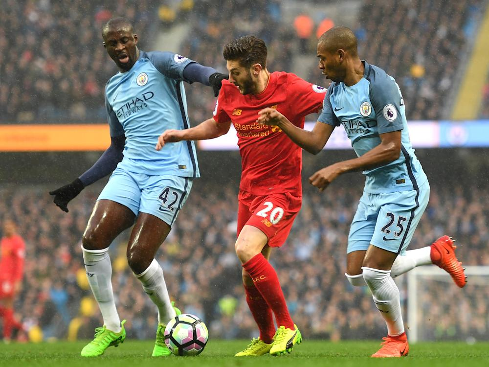 Adam Lallana glides past Yaya Toure and Fernandinho in the opening stages: Getty
