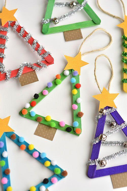 "<p>Just arrange three popsicle sticks in a triangle shape and secure with hot glue. Decorate them using pompoms, pipe cleaners, jingle bells, glitter, buttons, or any other details you like. Top with a glittery star and hang with twine.</p><p><em><a href=""https://onelittleproject.com/popsicle-stick-christmas-trees/"" rel=""nofollow noopener"" target=""_blank"" data-ylk=""slk:Get the tutorial at One Little Project»"" class=""link rapid-noclick-resp"">Get the tutorial at One Little Project»</a></em><br></p>"