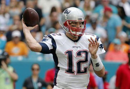 Jan 1, 2017; Miami Gardens, FL, USA;  New England Patriots quarterback Tom Brady (12) throws a pass during the first quarter of an NFL football game against the Miami Dolphins at Hard Rock Stadium. Mandatory Credit: Reinhold Matay-USA TODAY Sports