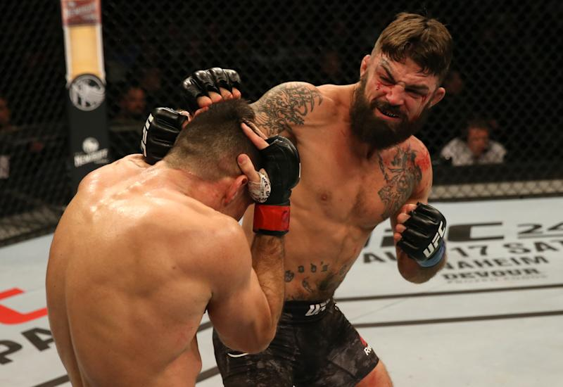 MONTEVIDEO, URUGUAY - AUGUST 10: (R-L) Mike Perry punches Vicente Luque in their welterweight fight during the UFC Fight Night event at Antel Arena on August 10, 2019 in Montevideo, Uruguay. (Photo by Alexandre Schneider /Zuffa LLC/Zuffa LLC)