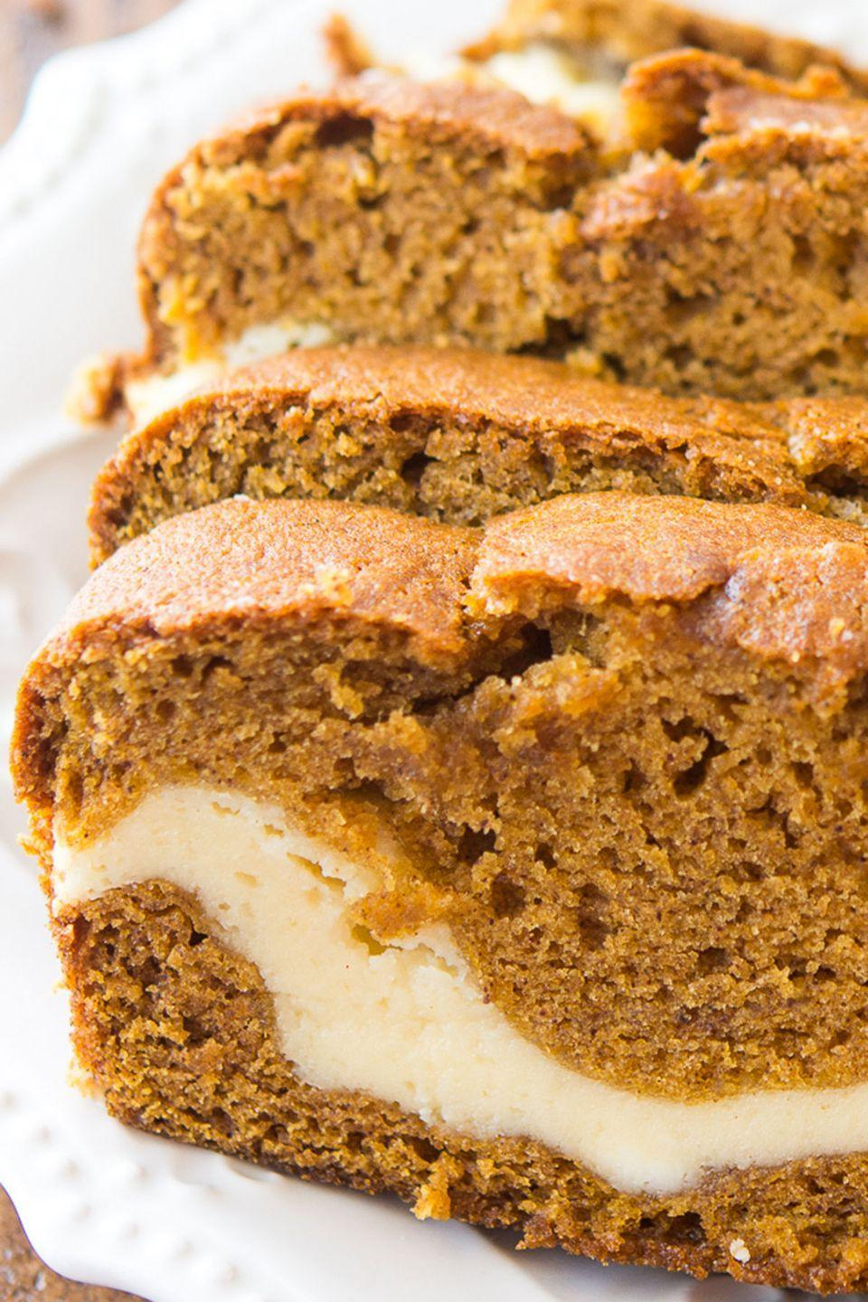"""<p>A white swirl of cream cheese is exactly what pumpkin bread needs. </p><p><strong>Get the recipe at <a href=""""http://dearcrissy.com/cream-cheese-filled-pumpkin-bread/#_a5y_p=5785476"""" rel=""""nofollow noopener"""" target=""""_blank"""" data-ylk=""""slk:Dear Crissy"""" class=""""link rapid-noclick-resp"""">Dear Crissy</a>. </strong></p>"""