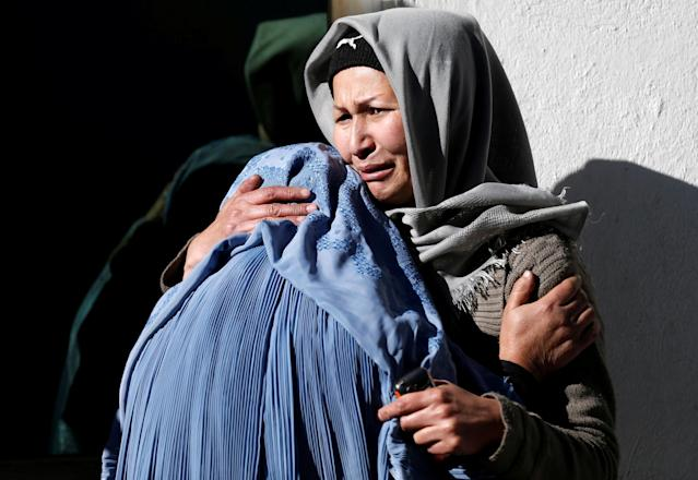 <p>Afghan women mourn inside a hospital compound after a suicide attack in Kabul, Afghanistan, Dec. 28, 2017 (Photo: Mohammad Ismail/Reuters) </p>
