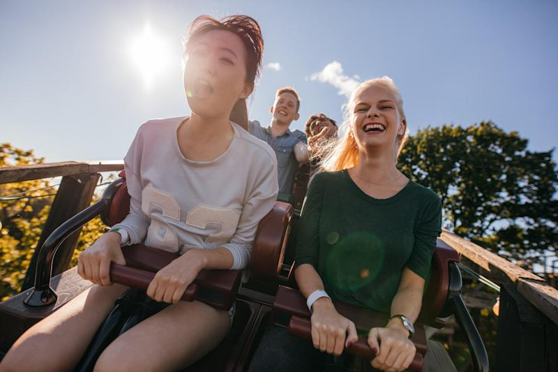 Two girls on a roller coaster ride.