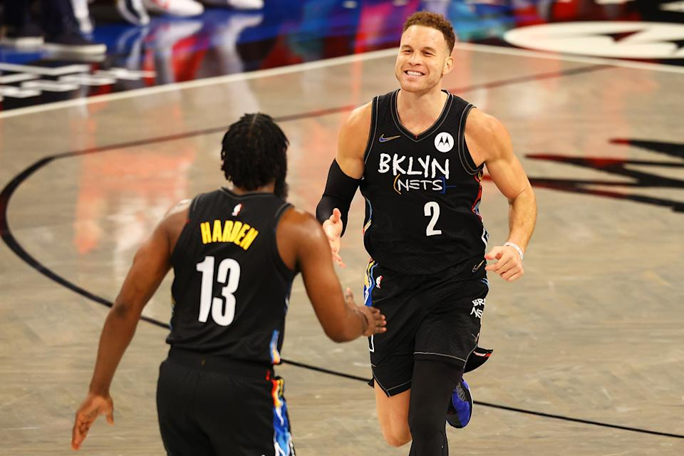 Blake Griffin of the Brooklyn Nets celebrates his dunk with James Harden
