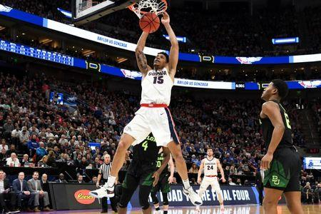 Mar 23, 2019; Salt Lake City, UT, USA; Gonzaga Bulldogs forward Brandon Clarke (15) dunks ahead pf Baylor Bears guard Mario Kegler (4) during the second half in the second round of the 2019 NCAA Tournament at Vivint Smart Home Arena. Mandatory Credit: Kirby Lee-USA TODAY Sports