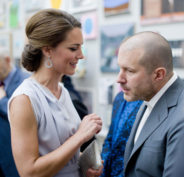 The Duchess of Cambridge talks with designer Jonathan Ive, the senior vice president of Industrial Design at Apple, at the Royal Academy of Arts in London for the UK creative industries reception hosted by the British Government supported by the Founders Forum, Monday, July 30, 2012. (AP Photo/Geoff Pugh)