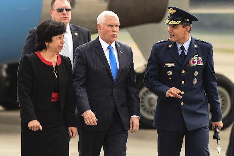 US Vice President Mike Pence (C) is welcomed by Colombia's Foreign Affairs Vice Minister Luz Stella Jara (L) and Colombia's Air Force General Luis Carlos Cordoba, upon arrival in Bogota, on February 25, 2019 (AFP Photo/JOAQUIN SARMIENTO)