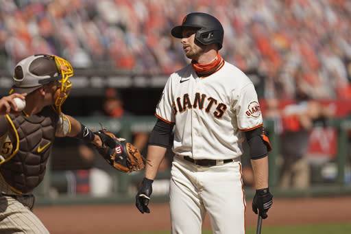 San Francisco Giants' Austin Slater reacts after striking out looking against San Diego Padres starting pitcher Adrian Morejon in the third inning of a baseball game Sunday, Sept. 27, 2020, in San Francisco. (AP Photo/Eric Risberg)