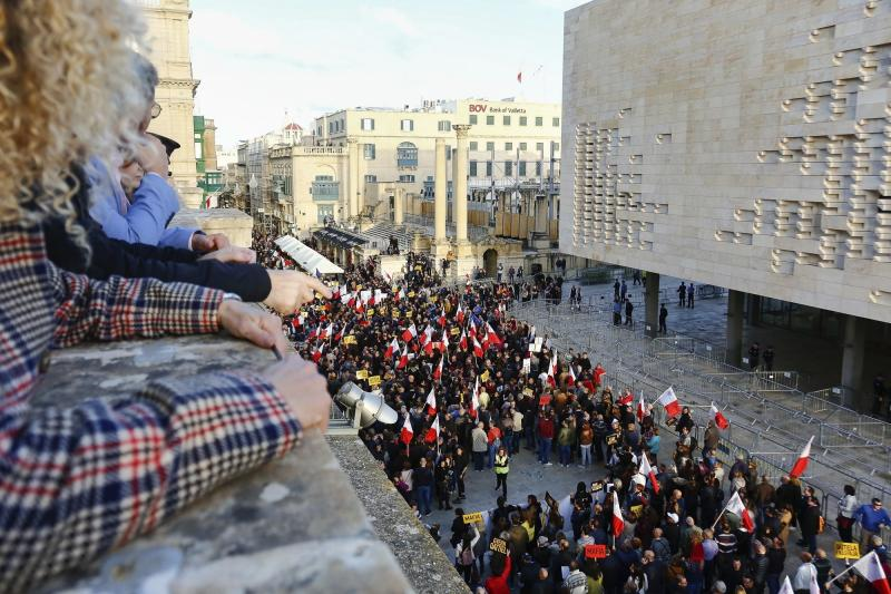 People stage a protest in La Valletta, Malta, Sunday, Dec. 1, 2019. Malta's embattled prime minister has received a pledge of confidence from Labor Party lawmakers amid demands for his resignation by citizens angry over alleged links of his former top aide to the car bomb killing of a Maltese anti-corruption journalist. Hours later, thousands of Maltese protested outside a courthouse demanding that Joseph Muscat step down. (AP Photo)