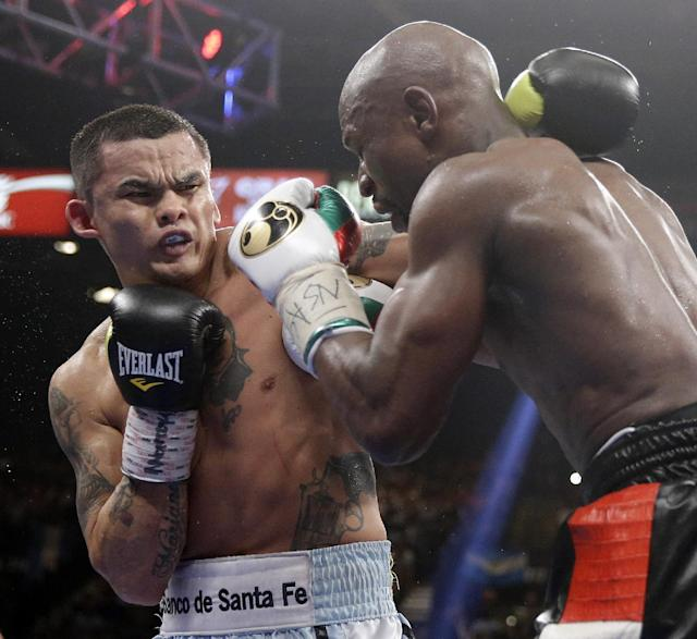 Marcos Maidana, left, from Argentina, trades blows with Floyd Mayweather Jr. in their WBC-WBA welterweight title boxing fight Saturday, May 3, 2014, in Las Vegas. (AP Photo/Isaac Brekken)
