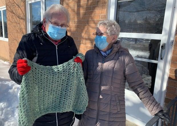 Erma Black and Gerry Heart are members of Heart and Hands, a group of seniors with the Main Street Baptist Church in Sackville who make and give shawls out to people in need of comfort. They recently handed out their 500th shawl. (Tori Weldon/CBC - image credit)