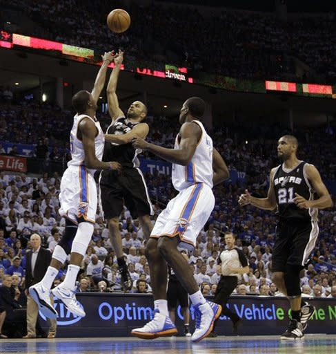 San Antonio Spurs guard Tony Parker (9), of France, shoots over Oklahoma City Thunder forward Kevin Durant (35) as Thunder's Serge Ibaka (9) and Spurs' Tim Duncan (21) move in during the first half of Game 4 in the NBA basketball playoffs Western Conference finals, Saturday, June 2, 2012, in Oklahoma City. (AP Photo/Eric Gay)