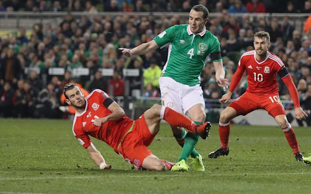 <span>Gareth Bale is booked for a high challenge on John O'Shea that rules him out of the Serbia match in June</span> <span>Credit: Paul Currie/BPI/REX/Shutterstock </span>