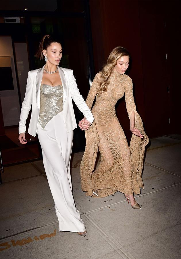 Gigi Hadid took a bit of tumble as she was leaving the Glamour Women of the Year Awards with her sister Bella. (Photo: Getty Images)
