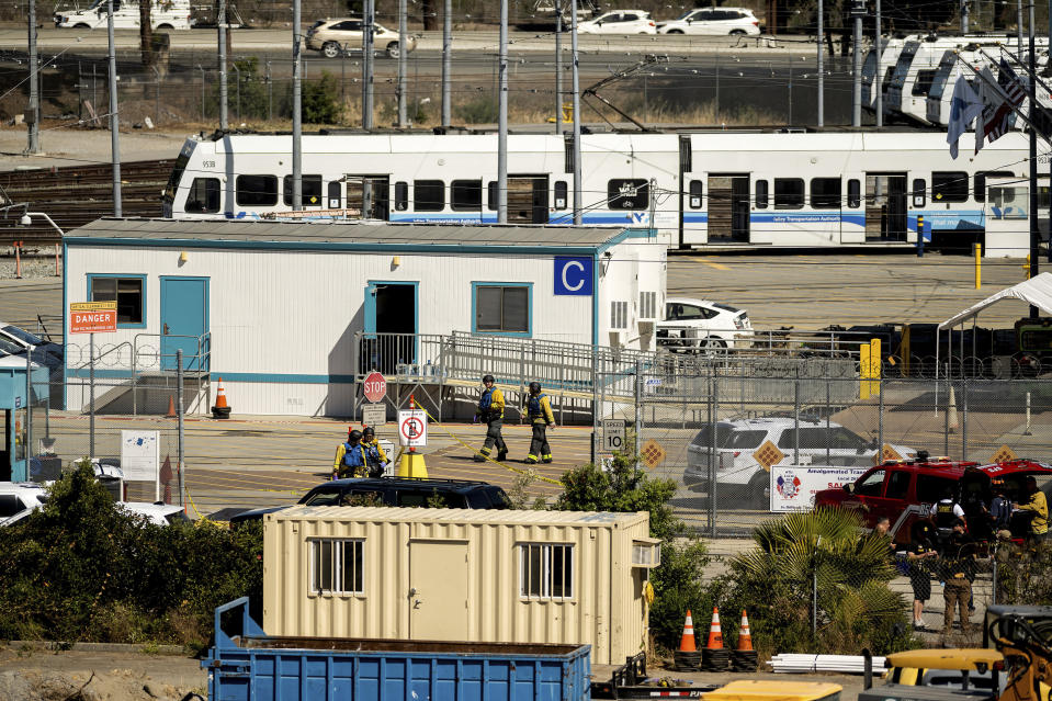 Emergency personnel respond to a shooting at a Santa Clara Valley Transportation Authority (VTA) facility on Wednesday, May 26, 2021, in San Jose, Calif. Santa Clara County sheriff's spokesman said the rail yard shooting left multiple people, including the shooter, dead. (AP Photo/Noah Berger)