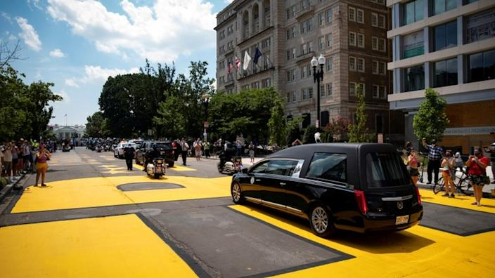 The casket of civil rights pioneer John Lewis, who died July 17, drives on 16th Street, renamed Black Lives Matter Plaza, near the White House, in Washington