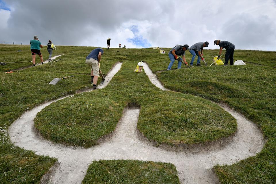 """""""Every archaeologist I know, including me, had it wrong,"""" said one independent geoarchaeologist about the age of the Cerne Abbas Giant. (Photo: Ben Birchall - PA Images via Getty Images)"""