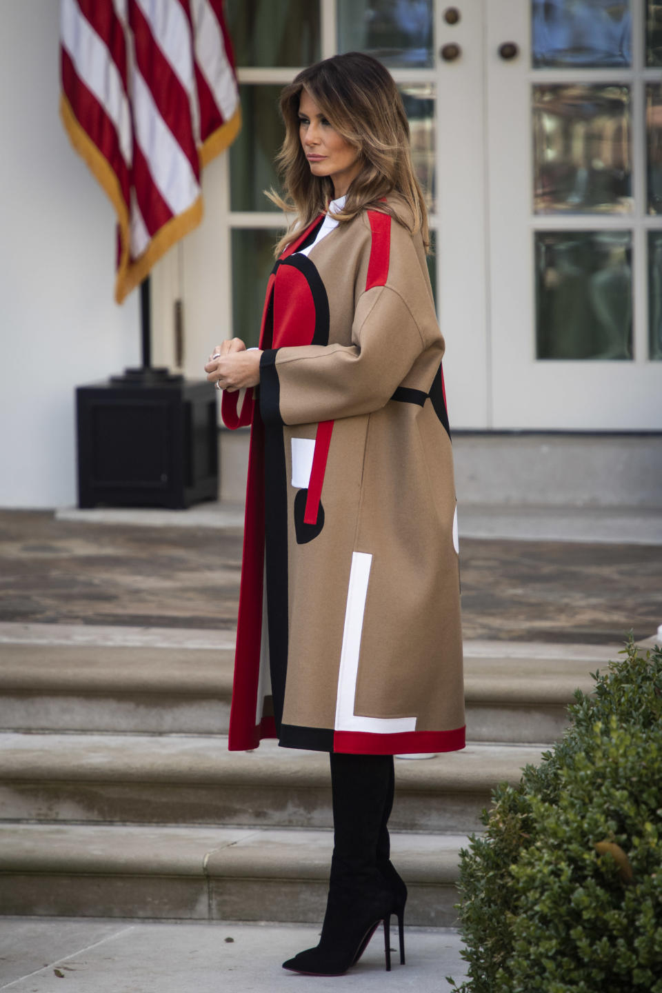 The First Lady wore a statement, $9000 (£7000) coat to celebrate the traditional National Thanksgiving Turkey Presentation. The outerwear piece was made by Dior – one of Melania's go-to labels. [Photo: Getty]