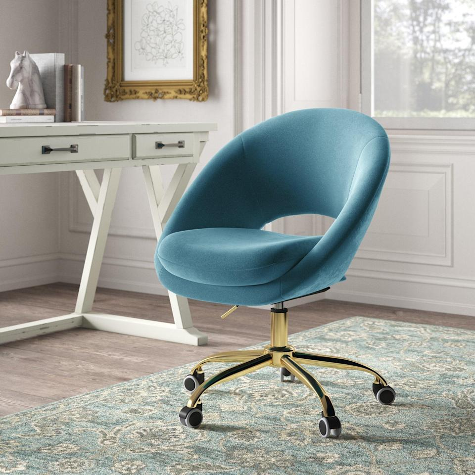 "<br><br><strong>Kelly Clarkson Home</strong> Lourdes Velvet Task Chair, $, available at <a href=""https://go.skimresources.com/?id=30283X879131&url=https%3A%2F%2Fwww.wayfair.com%2Ffurniture%2Fpdp%2Fkelly-clarkson-home-lourdes-velvet-task-chair-w003317863.html"" rel=""nofollow noopener"" target=""_blank"" data-ylk=""slk:Wayfair"" class=""link rapid-noclick-resp"">Wayfair</a>"