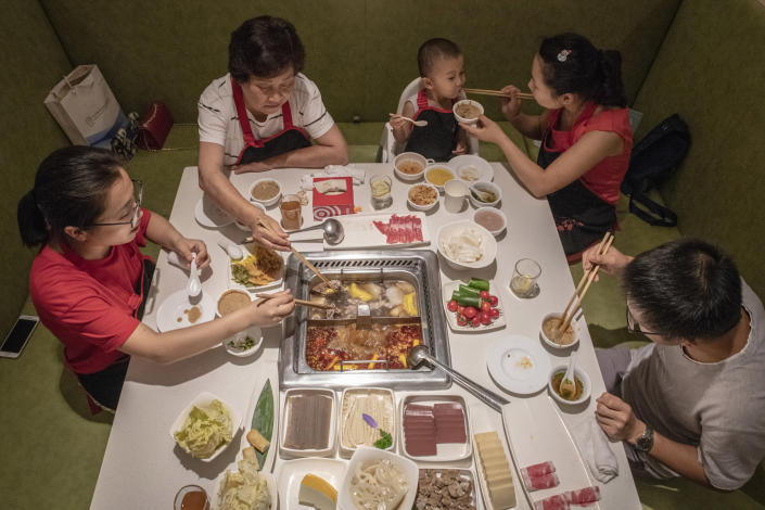 Diners at a Haidilao, China's most popular hot pot chain, in Beijing, June 30, 2018. (Gilles Sabrie/The New York Times)