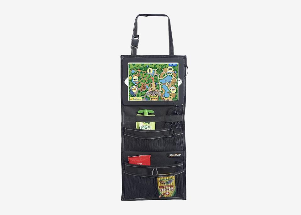 """<p>If you've got little ones in the back seat, one of these over-the-seat organizers can help keep their snacks, coloring books, and iPad or tablet under control. The more pockets, the better, which is why we like this <a href=""""https://amzn.to/3fvTDj2"""" rel=""""nofollow noopener"""" target=""""_blank"""" data-ylk=""""slk:High Road organizer"""" class=""""link rapid-noclick-resp"""">High Road organizer</a>, with five mesh and fabric pockets, plus a sleeve for tablets. Another solid option: <a href=""""https://www.target.com/p/12-x15-back-seat-organizer-with-tray-black-turtle-wax/-/A-75574863"""" rel=""""nofollow noopener"""" target=""""_blank"""" data-ylk=""""slk:Turtle Wax's seat organizer"""" class=""""link rapid-noclick-resp"""">Turtle Wax's seat organizer</a>, which has a drop down tray better suited for older kids.</p> <p><strong>Buy now:</strong> <a href=""""https://amzn.to/2N5Ktxu"""" rel=""""nofollow noopener"""" target=""""_blank"""" data-ylk=""""slk:$8, amazon.com"""" class=""""link rapid-noclick-resp"""">$8, amazon.com</a></p>"""
