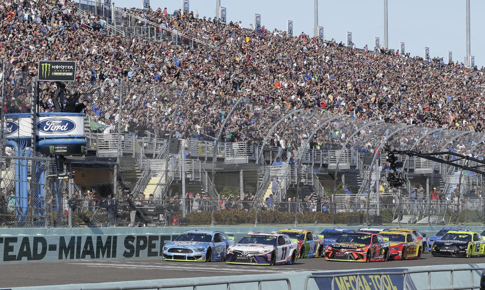 Denny Hamlin (11) leads the field to start the NASCAR Cup Series auto race on Sunday, Nov. 17, 2019, at Homestead-Miami Speedway in Homestead, Fla. (AP Photo/Terry Renna)
