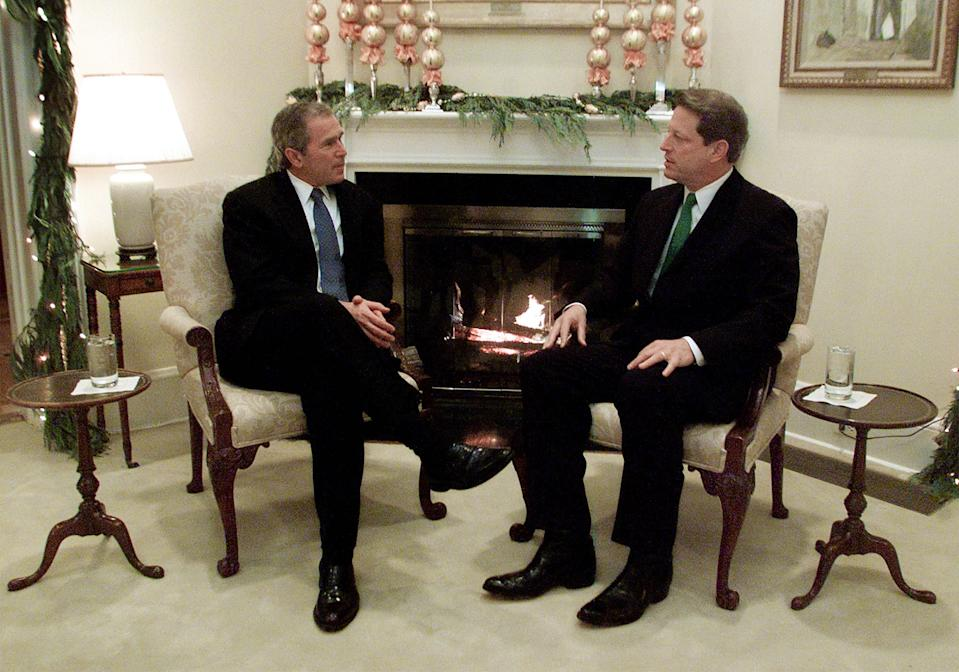 Vice President Al Gore (R) meets with President-elect George W. Bush in the living room of the vice president's residence in Washington, December 19, 2000. Bush and Gore met for the first time since the final debate during the election campaign.