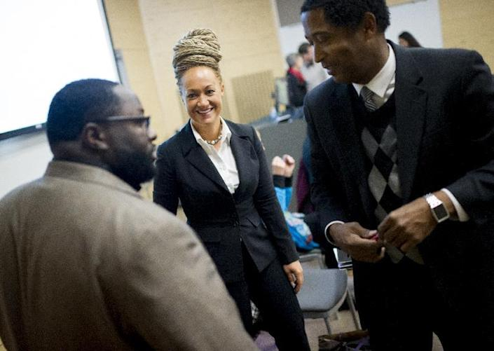 Rachel Dolezal, Spokane's newly elected NAACP President, smiles as she meets with Joseph M. King of King's Consulting, left, and Dr. Scott Finnie, director and senior professor of EWU's Africana Education Program before the start of a Black Lives Matter Teach-In on Public Safety and Criminal Justice at EWU in Cheney, Wash. (Tyler Tjomsland/The Spokesman-Review)