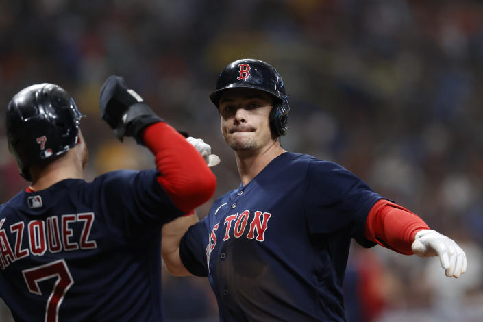Boston Red Sox's Bobby Dalbec celebrates his two-run home run with Christian Vazquez (7) during the fifth inning of a baseball game against the Tampa Bay Rays on Saturday, July 31, 2021, in St. Petersburg, Fla. (AP Photo/Scott Audette)