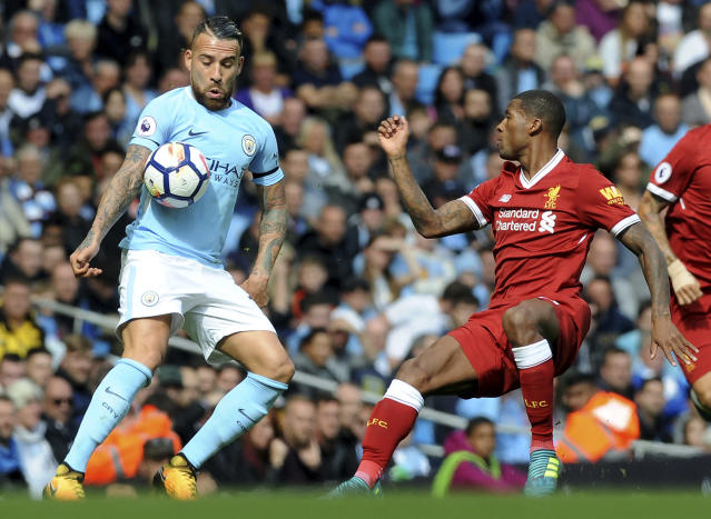<p>Manchester City's Nicolas Otamendi, left, and Liverpool's Georginio Wijnaldum, right, battle for the ball </p>