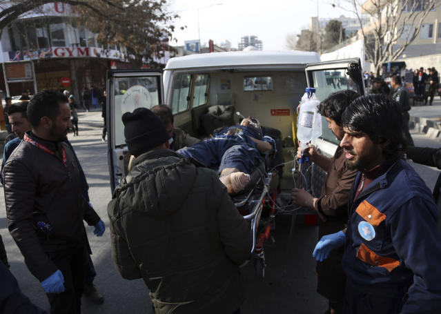 <p>An injured man is moved by a stretcher outside a hospital following a suicide attack in Kabul, Afghanistan, Saturday Jan. 27, 2018. (Photo: Rahmat Gul/AP) </p>