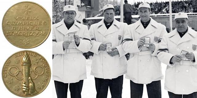 "<p>After a 12-year absence, the 1948 Games were the first held after World War II and were called the ""Games of Renewal."" The medal features snow crystals, the Olympic Rings, and a hand holding a lit torch.<br> (IOC photo; United States gold medalists for the Four-Man Bobsled in St. Moritz, Switzerland, 1948/photo by Getty Images) </p>"