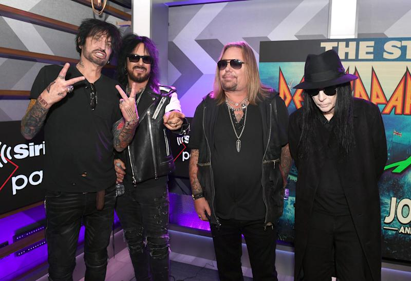 HOLLYWOOD, CALIFORNIA - DECEMBER 04: Tommy Lee, Nikki Sixx, Vince Neil, and Mick Mars of Mötley Crüe attend the Press Conference with Mötley Crüe, Def Leppard, and Poison announcing 2020 Stadium Tour on December 04, 2019 in Hollywood, California. (Photo by Kevin Winter/Getty Images)