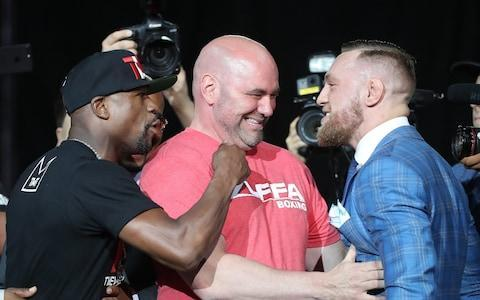 <span>Dana White (centre) has defended the high cost of purchasing the fight</span> <span>Credit: Reuters </span>