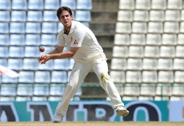 Mitchell Marsh fractured his right hand punching a wall, prompting Australian coach Justin Langer to brand him 'an idiot' (AFP Photo/LAKRUWAN WANNIARACHCHI)
