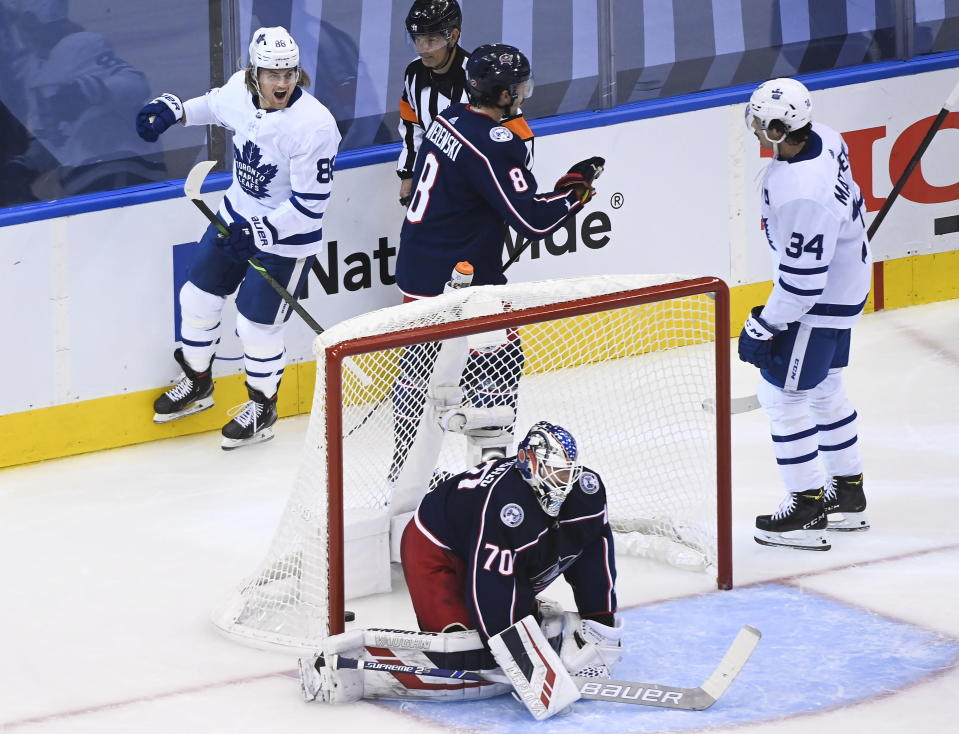 Toronto Maple Leafs right wing William Nylander (88) celebrates his goal with teammate Auston Matthews (34) as Columbus Blue Jackets goaltender Joonas Korpisalo (70) and teammate Zach Werenski (8) look on during the second period of an NHL hockey playoff game Thursday, Aug. 6, 2020, in Toronto. (Nathan Denette/The Canadian Press via AP)