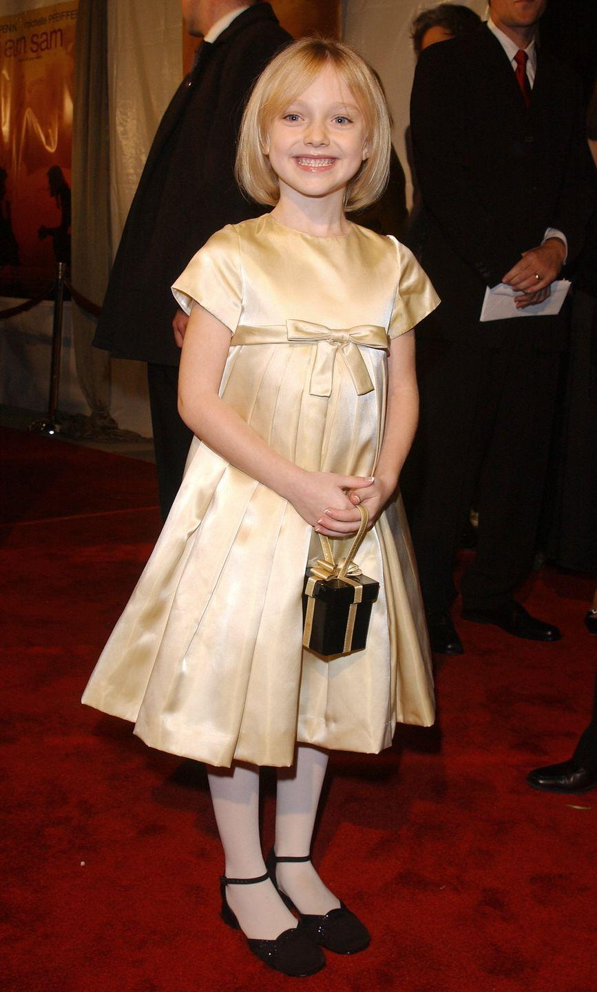 <p>In 2001, the 7-year-old starlet walked her first red carpet at the premiere of <em>I am Sam</em>. She'd go on to star in some of the biggest movies of the decade, including <em>War of the Worlds </em>and <em>Man on Fire.</em></p>