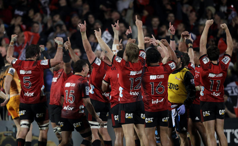 Crusaders players celebrate after defeating the Jaguars 19-3 to win the Super Rugby final in Christchurch, New Zealand, Saturday, July 6, 2019. (AP Photo/Mark Baker)