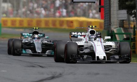 Formula One - F1 - Australian Grand Prix - Melbourne, Australia - 24/03/2017 Williams driver Lance Stroll of Canada leads Mercedes driver Valtteri Bottas of Finland during the first practice session. REUTERS/Jason Reed