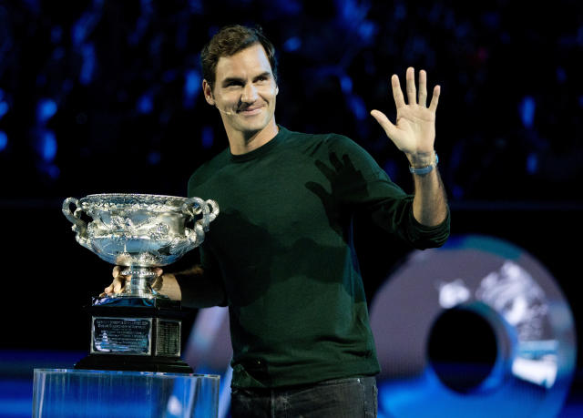 Defending men's singles champion Switzerland's Roger Federer waves to the crowd during a ceremony for the official draw at the Australian Open tennis championships in Melbourne, Australia Thursday, Jan. 11, 2018. (AP Photo/Mark Baker)