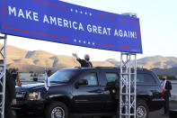 Vice President Mike Pence waves during a campaign rally at Reno-Tahoe International Airport in Reno Nev., Thursday, Oct. 29, 2020. (AP Photo/Lance Iversen)