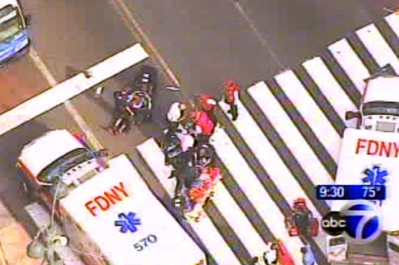 In this frame grab from WABC-TV, emergency personnel respond to reports of several people being shot outside the Empire State Building, Friday, Aug. 24, 2012, in New York. Authorities say the shooter is dead. (AP Photo/WABC-TV) MANDATORY CREDIT