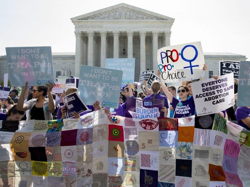 Pro-choice supporters rally outside the Supreme Court before the June 2016 court ruling in a case that imposed heavy restrictions on abortion clinics in Texas and was struck down EPA: EPA