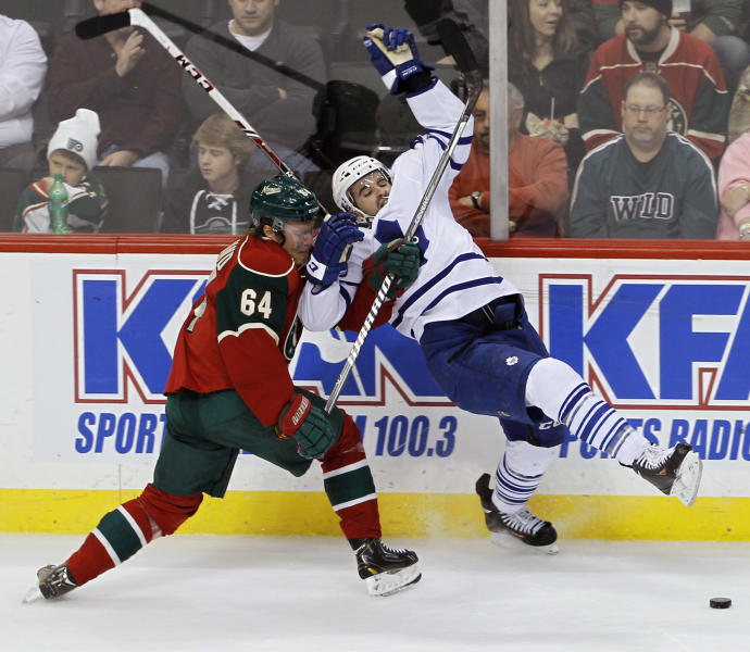 Toronto Maple Leafs center Nazem Kadri, right, and Minnesota Wild center Mikael Granlund (64), of Finland, tangle as they vie for the puck during the first period of an NHL hockey game in St. Paul, Minn., Wednesday, Nov. 13, 2013. (AP Photo/Ann Heisenfelt)