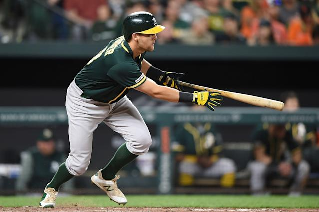 "<a class=""link rapid-noclick-resp"" href=""/mlb/players/10138/"" data-ylk=""slk:Chad Pinder"">Chad Pinder</a> is part of a surging Oakland offense (AP Photo/Gail Burton)"